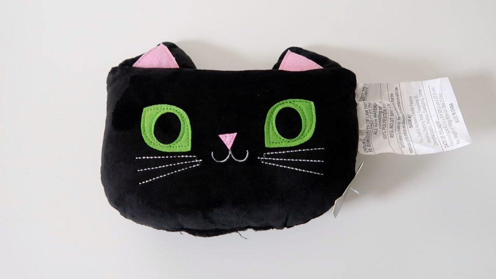 small black cat pillow